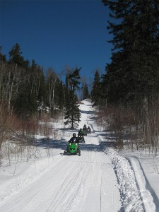 snowmobilers riding the gunflint trail system out of grand marais mn
