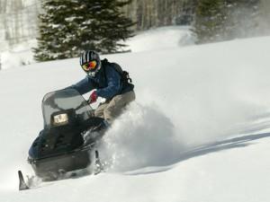 snowmobiler playing in powder lutsen mn snowmobile trail