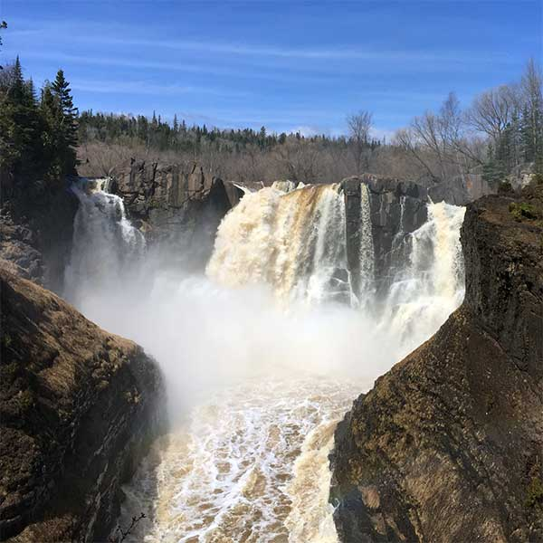 rushing spring waterfalls and mist at pigeon river grand portage state park