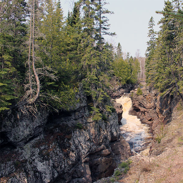 gorges of deep rock with temperance river passing through