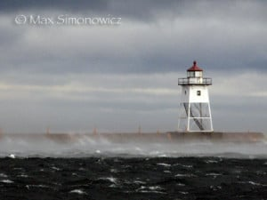 waves washing over grand marais breakwall