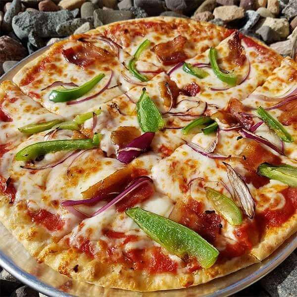 cheesy pizza with green peppers and red onions at cove point crossings in beaver bay