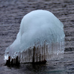 snow formation on rock with skirt of icicles in lake superior
