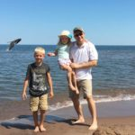 whale jumping behind family at park point in duluth mn