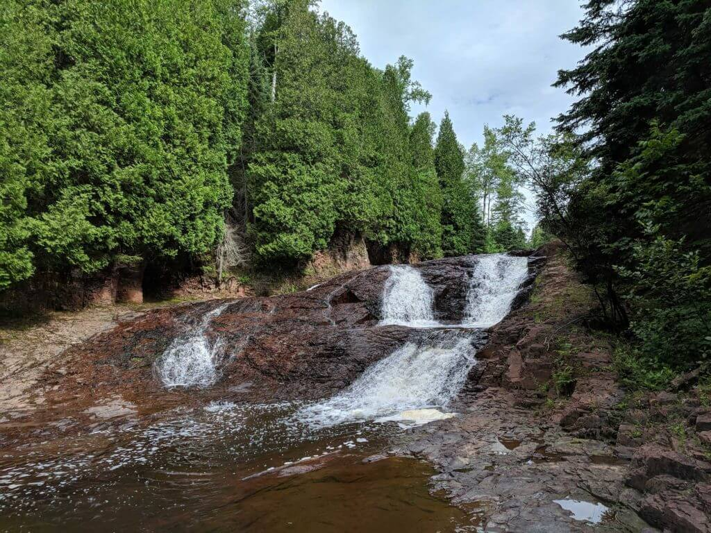 barely flowing summer waterfall at split rock river