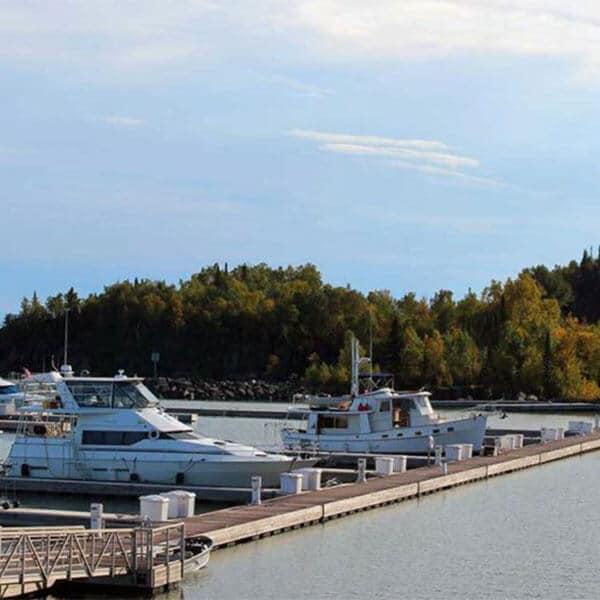 power boats docked at silver bay marina on lake superior