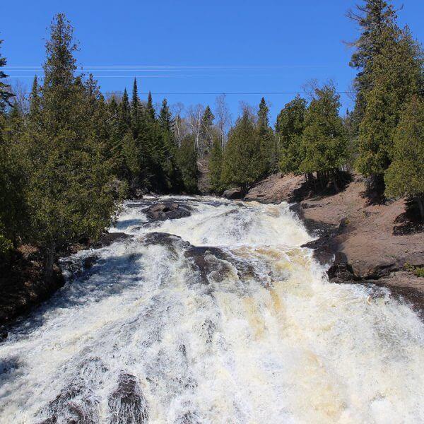 wide rushing cross river waterfalls in schroeder minnesota