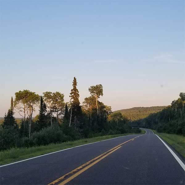 driving the gunflint trail with sawtooth mountains in background