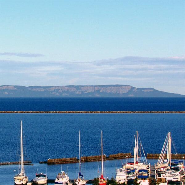 sailboats in thunder bay ontario marina overlooking bay and sleeping giant island