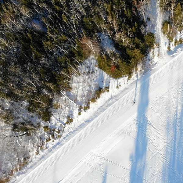 overhead view of cross country skier on groomed north shore ski trail near grand marais