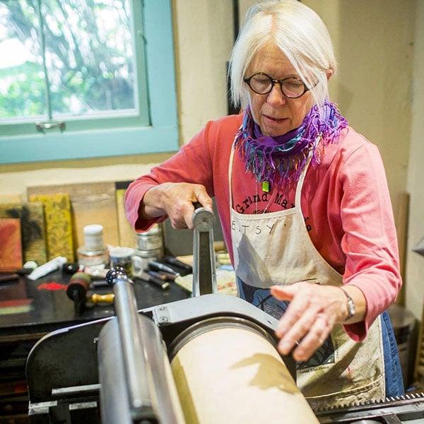 betsy bowen making woodcut prints at betsy bowen gallery and studios