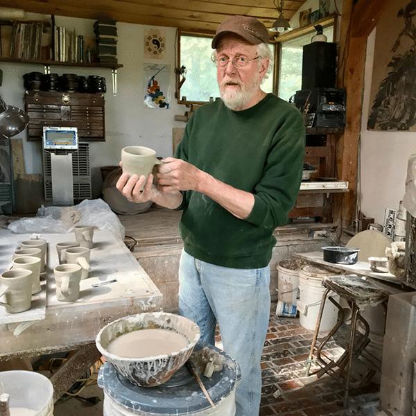 richard cooter making a mug at cooter pottery