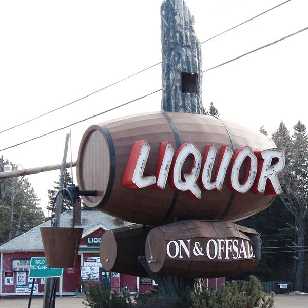 Green Door giant liquor barrel sign