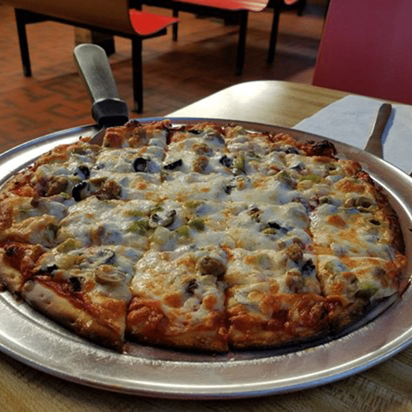 pizza on a table at jimmy's pizza
