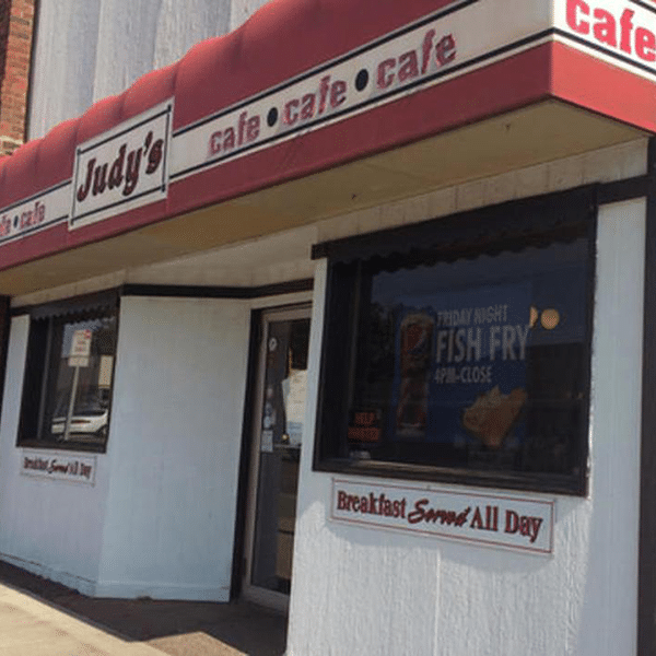 judy's cafe storefront and fish fry banner