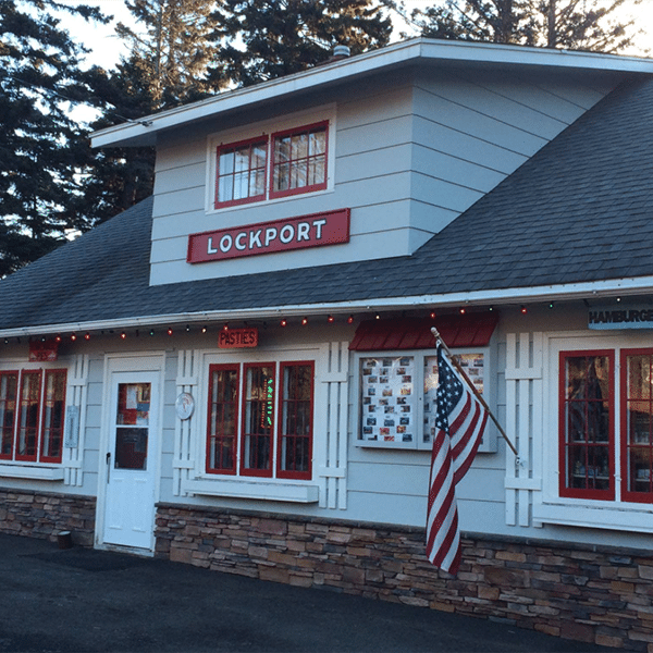lockport storefront signs and flag in summer