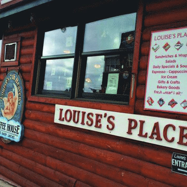 louise's place storefront and wall menu