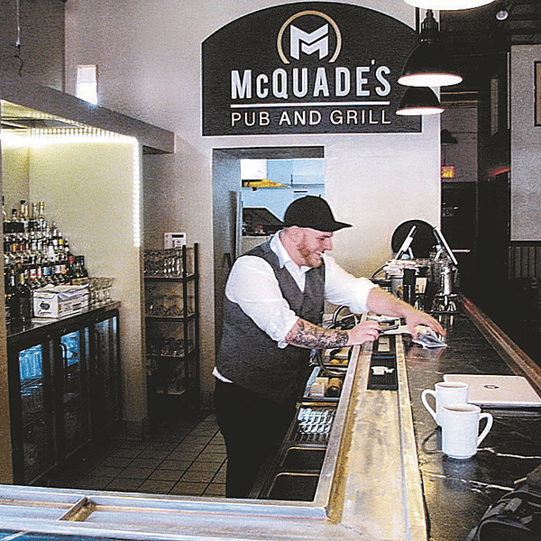 bar and bartender at McQuades pub and grill