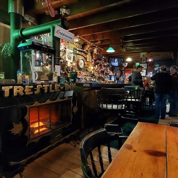 trestle inn fireplace people at bar enjoy drinks