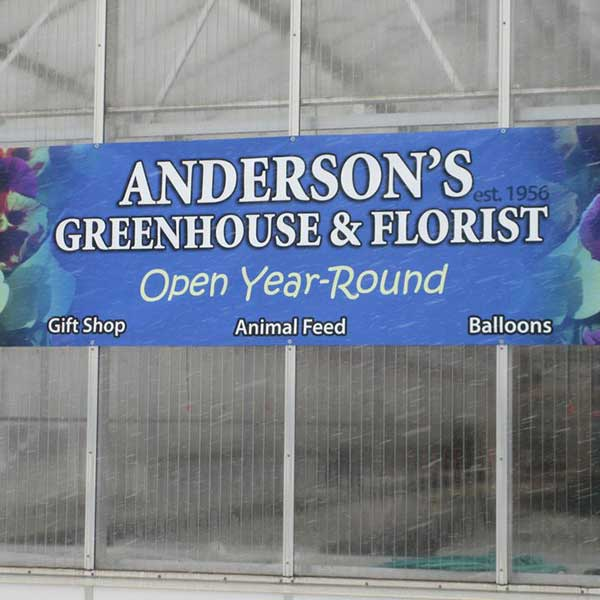 Commercial greenhouse with banner Anderson's Green House