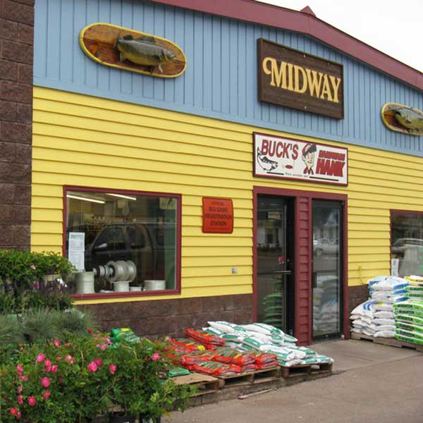 Plants and potting soil in front of Bucks hardware Grand Marais