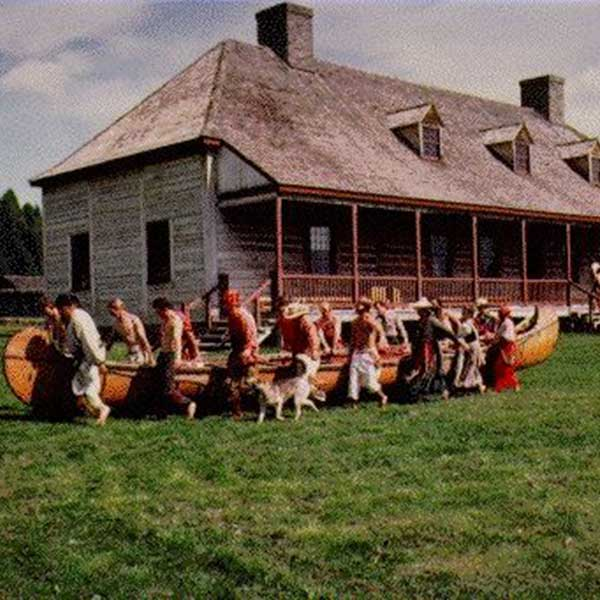 voyageurs with a birch bark canoe at the grand portage national monument