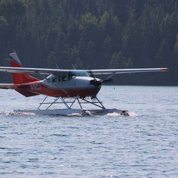 seaplane taxing across a bay at isle royale