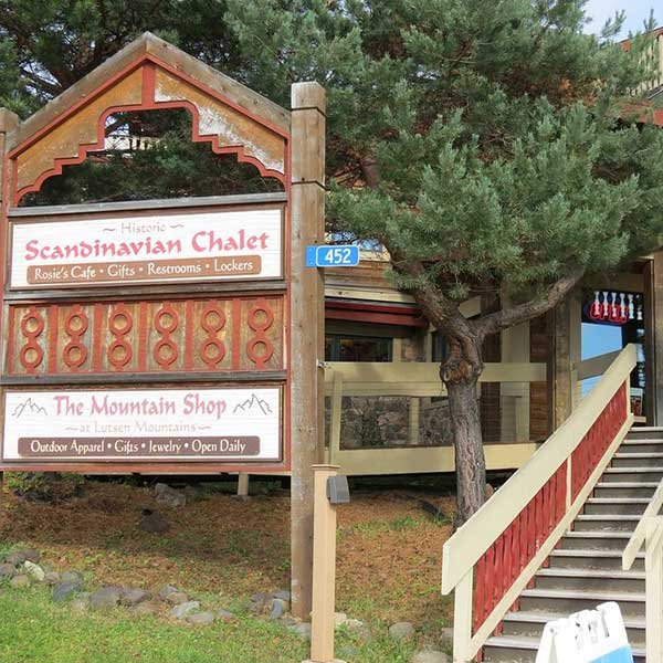 Wooden sign outside Shele for the Mountain shop at Lutsen