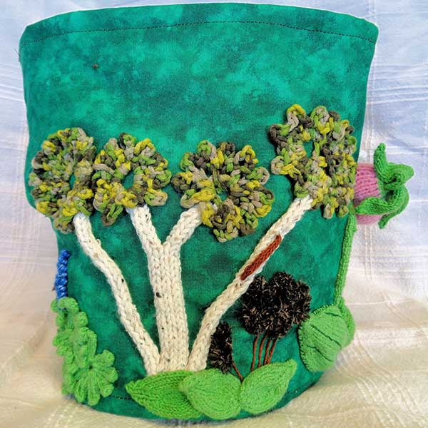 Net, beaded and felted tea cozy at playing with yarn in knife River