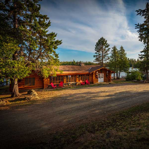 front of rockwood lodge with pine and cedar and lake backdrop