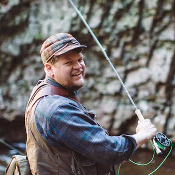 fly fisherman in a stream with stone harbor fly fishing guides