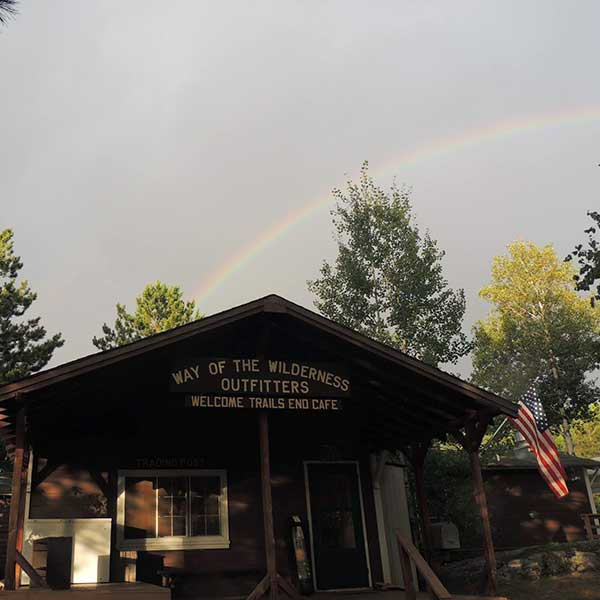 Rainbow over way of the wilderness outfitters, Café, shop