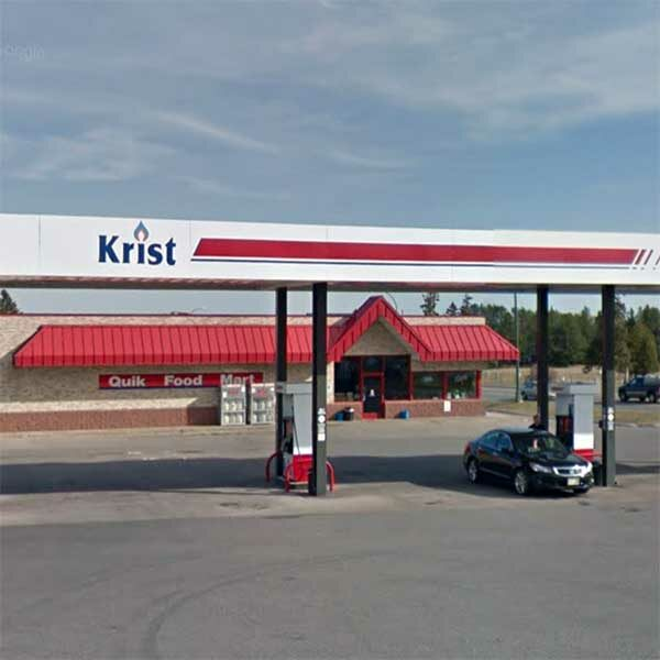pumps and exterior of krist gas station two harbors