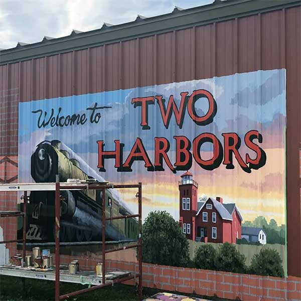 mural of locomotive lighthouse welcome to two harbors