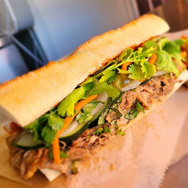 flavorful sandwich with meat and greens on a baguette