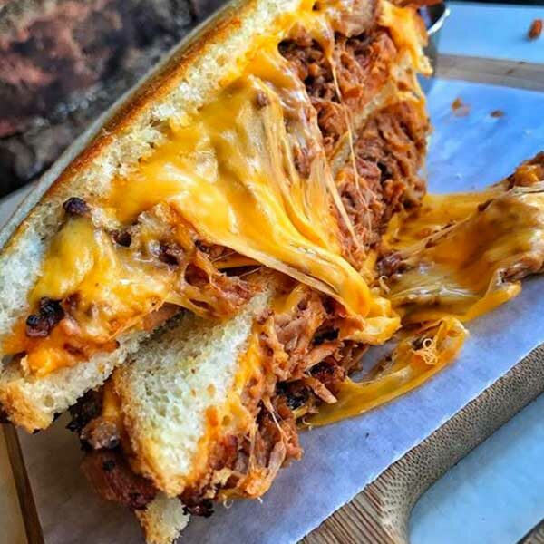 cheese melting out of bbq sandwich from shore happy food truck