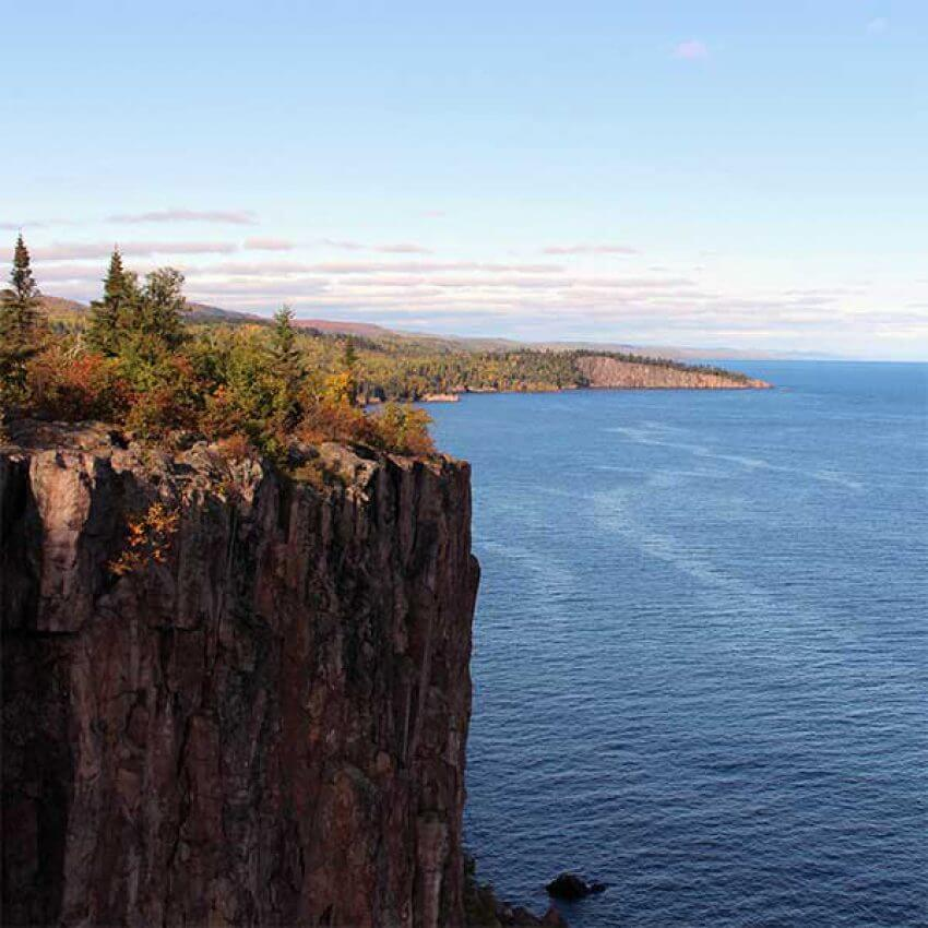 palisade head cliff rising out of lake superior