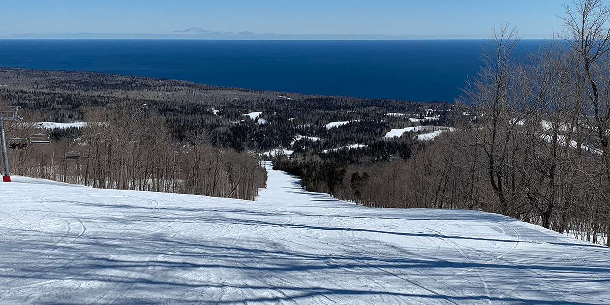 lutsen mountains groomed run and lake superior spread out below