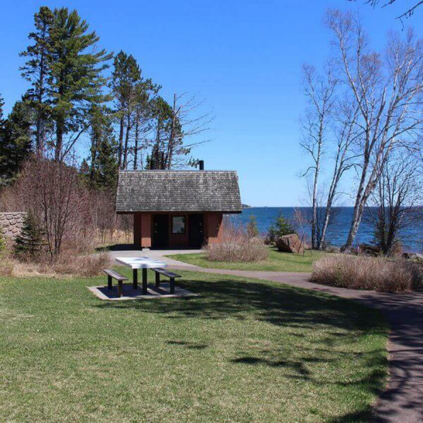 picnic tables and cobblestone beach on lake superior at cut face creek wayside rest
