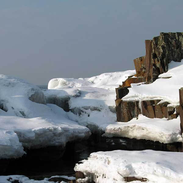 snow covered rocky outcropping of lake superior