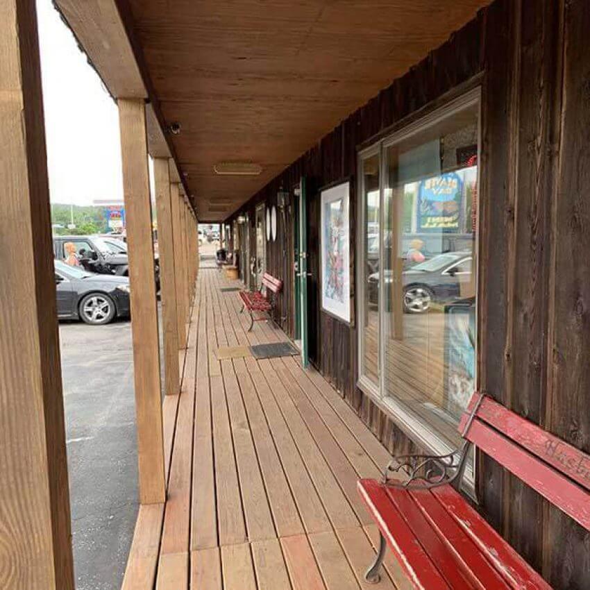 line of shops and restaurants along a boardwalk in beaver bay minnesota