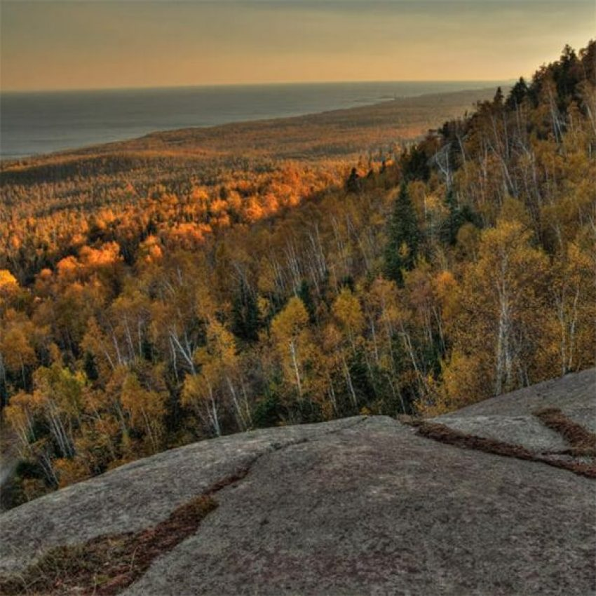 rock outcropping peak looking over maples and birch to lake superior from carlton peak mn