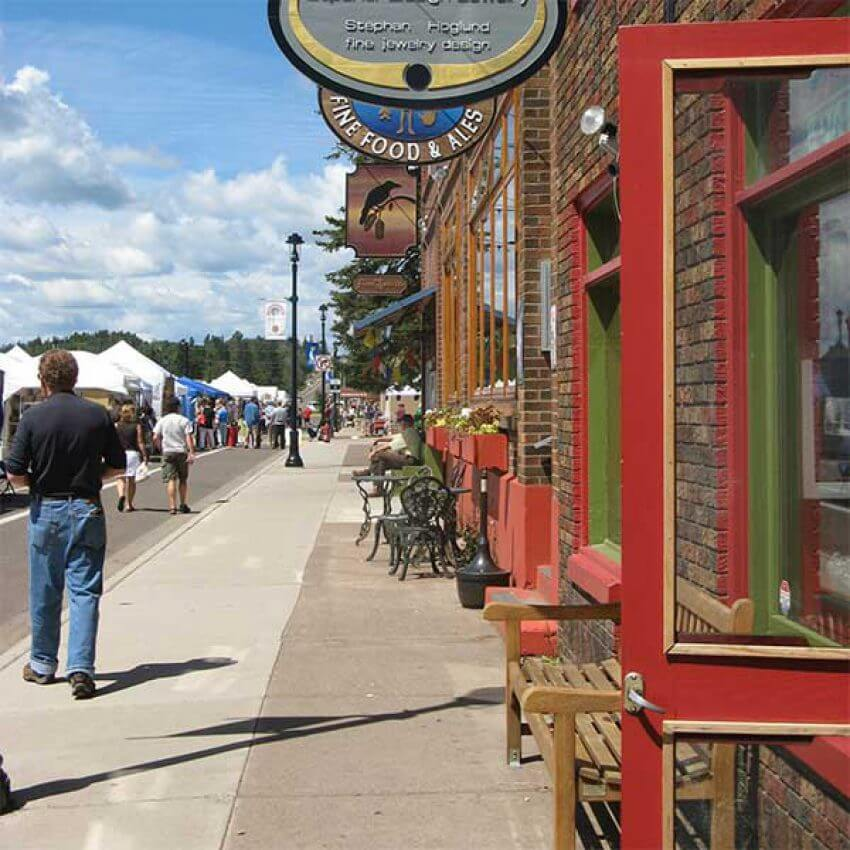 line of shops and restauarnts on main street grand marais mn