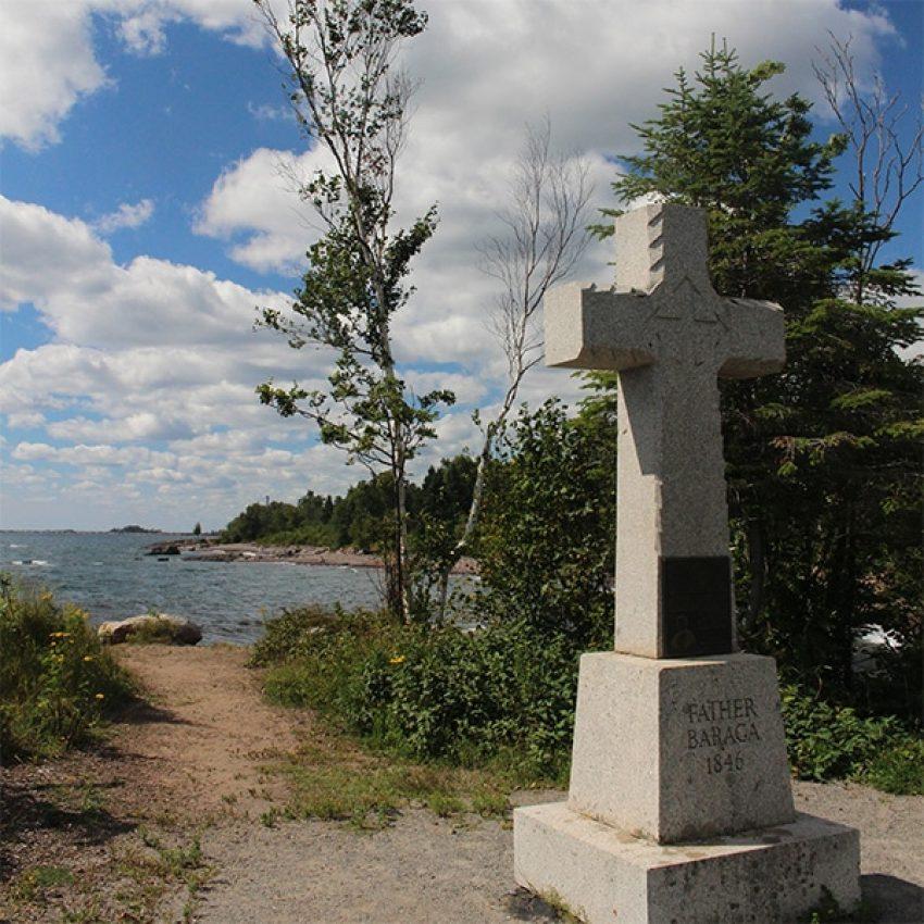 concrete father baraga cross on shore of lake superior