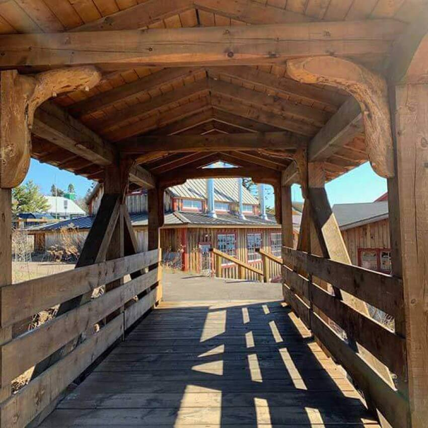 covered bridge connecting campground to downtown in grand marais mn