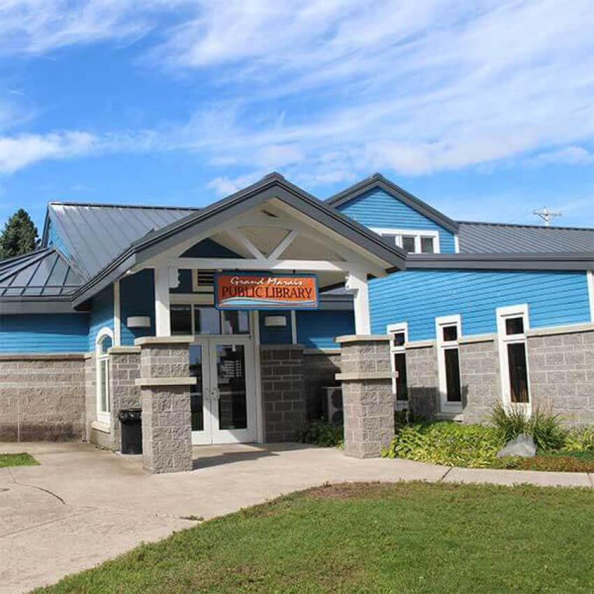 covered entry and lawn of grand marais public library