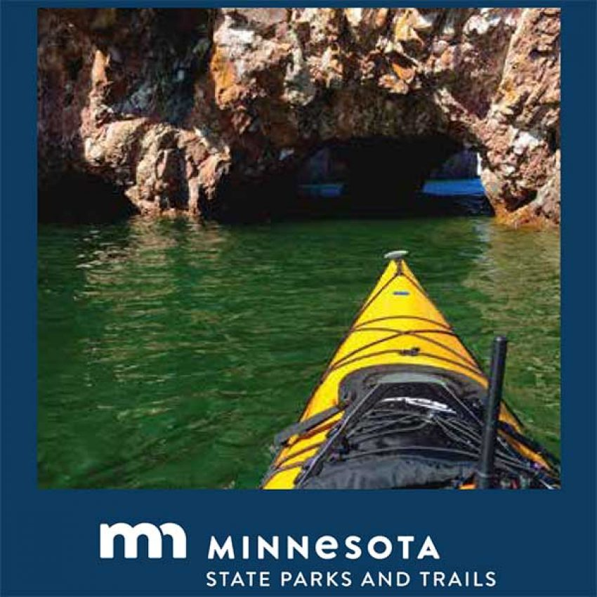 looking over yellow kayak to lake superior sea cave