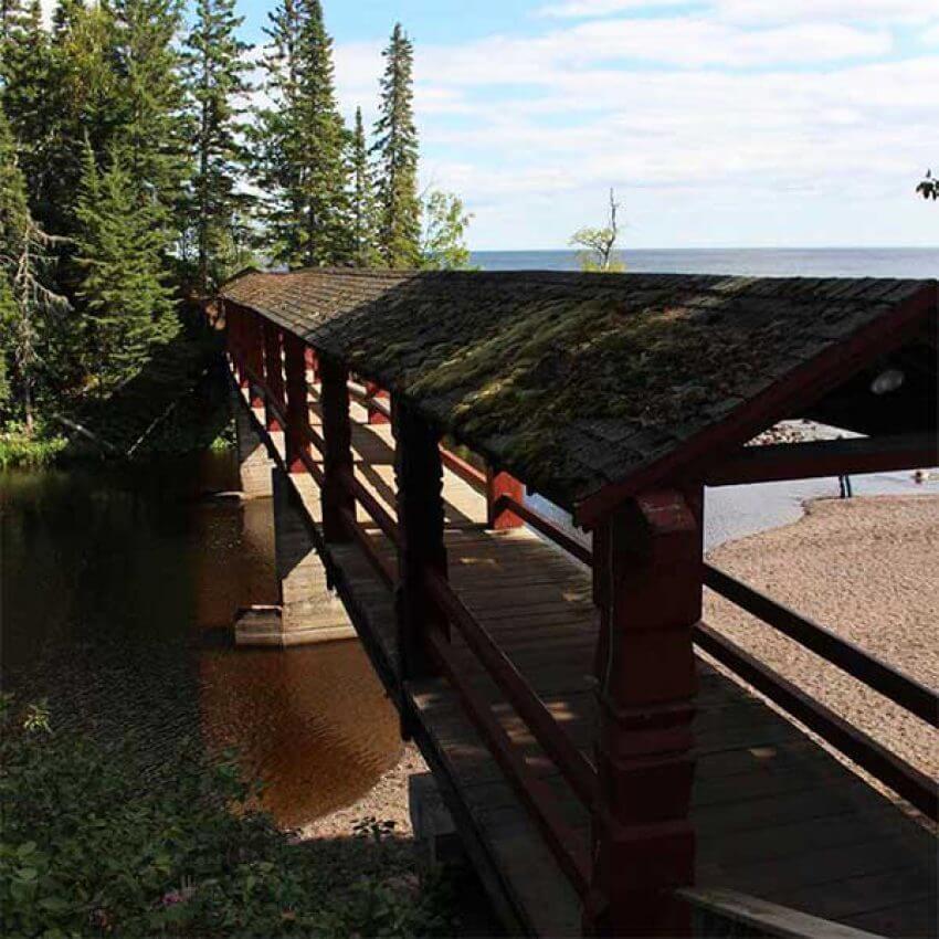 romantic covered bridge over poplar river in lutsen on lake superior