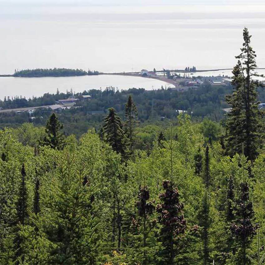 view from pincushion overlook over grand marais mn and lake superior