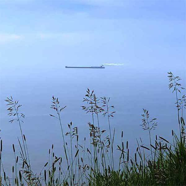 1000-foot iron ore ship sailing up lake superior of scenic highway 61